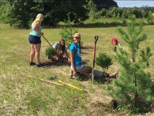 Girls Planting Trees at the Kudner Property