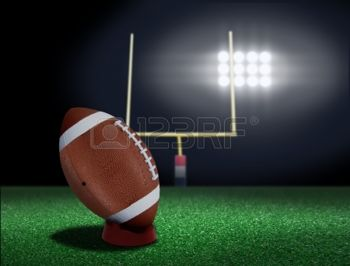 11885724-football-on-tee-ready-to-be-kicked-off